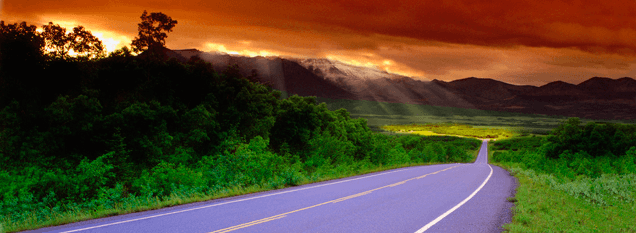 Picture of an open road leading into the sunset